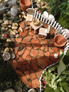 Broken pot fairy garden patio made with pottery shards