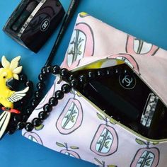 Beauty case#pink#apples#hand drawing#textil product#Dobromila's deawing#spoon flower#textil print#Fanny#sewing#styling & Photo Dobromila#bleu#cosmetic#colier#necklace#parrot#yellow#black#