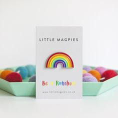 Rainbow enamel pin badge on a motivational 'be a rainbow card. By Little Magpies.