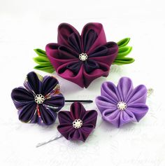 Shades of purple t kanzashi by offgenemi - nice example of nesting different sized petals.