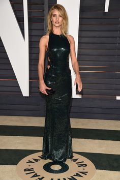 Rosie Huntington-Whiteley The supermodel stunned in body-hugging Alexandre Vauthier gown with liquid shine.