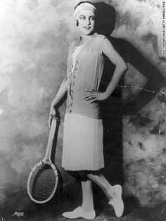 Suzanne Lenglen showing how to work a tennis dress and pumps. I am totally in love with the sleeveless lightweight knit cardigan.