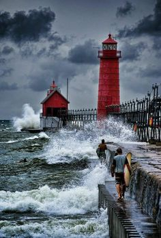 GRAND HAVEN LIGHTHOUSE. The memories of taking the boat 30 miles south from Muskegon Michigan - Robert Resnick: Grand Haven Lighthouse. Notice idiots on pier. Beautiful Places, Beautiful Pictures, Lighthouse Pictures, Grand Haven, Lake Michigan, Michigan Usa, Belle Photo, Scenery, Places To Visit