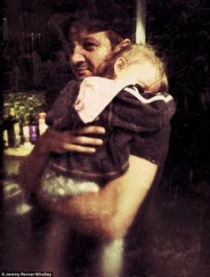Daddy's girl: Jeremy Renner hugged his young daughter, Ava,in a photo shared on WhoSay on ...