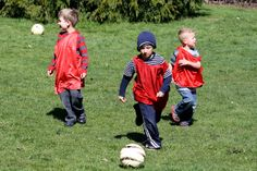 Red team's forward line works the ball down the field.