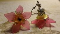 Pink & Yellow Acrylic Lucite Flower Earrings  Beautiful flower earrings that are layered with pink, orange & yellow acrylic lucite flower beads, accented with silver bead caps & a swarovski crystal as the flower piston. Hangs from a french hook ear...