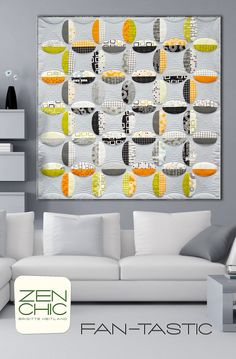 This is FAN-TASTIC! The machine appliquéd shapes like blades of a fan come all from one layer cake and the background are squares from another grey layer cake. Featuring REEL TIME by ZEN CHIC