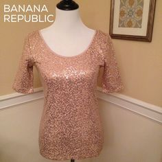 BANANA REPUBLIC Sequined Top NWOT! This stunning sequined, scoop neck top from Banana Republic is ready to add sparkle to your style! Metallic trim around neck. 3/4 sleeves. 100% cotton. NWOT! Banana Republic Tops