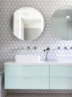 We're not over hexagonal tiles yet ! Simple white hegagonal tiles with this pastel vanity and round mirror. Hexagon Tiles, Interior, White Hexagon Tiles, Modern Bathroom Design, Bathroom Mirror, Round Mirror Bathroom, Bathroom Interior, Small Bathroom, Tile Bathroom