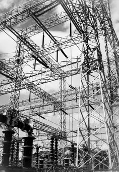 """Boulder Dam Power Units, 1941,"" vertical, looking up at wires."