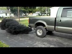 6.0 liter Powerstroke lope and smoke: Now THATS rollin coal!! God i love the sound of this truck. sounds like a tractor ;)