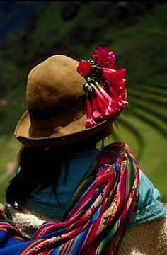 Girl of Pisaq adorned in traditional attire and cantuta flowers, Sacred Valley.  Photo: Mylene d'Auriol Stoessel.