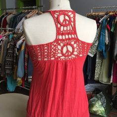 Rachel & Chloe Peace sign Racer back tank So soft! Adjustable in the front. I'm lusting this as a small because I'm an XS and it fits me! In used condition. But no stains or rips Rachael & Chloe Tops Tank Tops