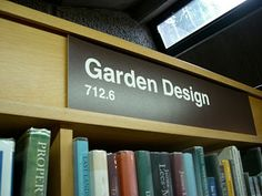 The Barbican Library is a a public library located in the Barbican Center in the City of London. The Barbican is an arts and resident. Library Signage, Barbican, July 6th, London City, Garden Design, Bookcase, Home, Ad Home