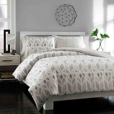 A contemporary geometric pattern in shades of grey brings chic style to the Grayson reversible duvet cover set. Crafted with pure cotton, this handsome duvet cover is paired with two matching shams and is fully machine washable.