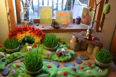Nature table with wheat grass, wool roving and a tree on which to hang spring-themed ornaments. Waldorf Crafts, Waldorf Toys, Steiner Waldorf, Waldorf Playroom, Spring Nature Table, Easter Crafts, Crafts For Kids, Deco Nature, Small World Play