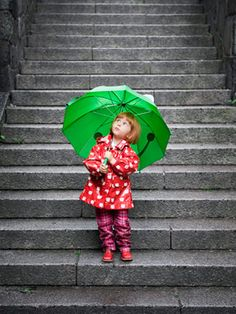 Little girl in red with a green umbrella. Can't handle it!