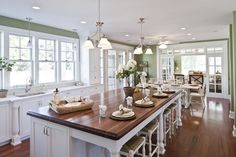 You may prefer a wood countertop for the island if you will be eating there--reminiscent of a table. Stone can be cold! --Note the transom window into the next room.