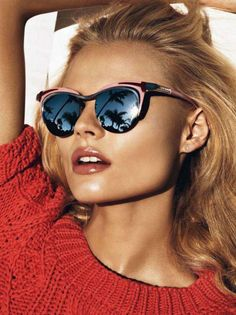 A sweater and sunnies for the almost warm weather.  VOGUE Paris April 2012.