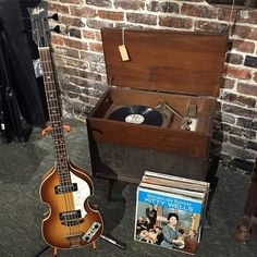 "Vintage record player, vinyl & Hofner ""Beatle"" Bass! All available at our shop!"