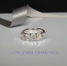FIVE stunning emerald cut diamonds, ONE spectacular eternity ring