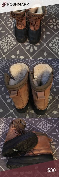 EDDIE BAUER Women's Thinsulate Boots Eddie Bauer Thinsulate Rain/Winter/hiking boots.  They are in very good condition.. Shows normal wear.  Black rubber and brown/tan leather upper ( small stain on leather see pic #3).  Fleece lined so super warm.  Steel Shank.  Size 7 but runs a little big.  I'm a size 8 and these fit me. Eddie Bauer Shoes Winter & Rain Boots