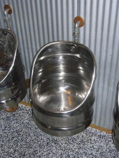 it really doesn't get better than a urinal made from an old keg...