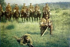 An old image showing several Dragoon guards of the Queen's Bays during the First World War. The colour image was published by the Illustrated London News to show their readers how the British khaki uniforms appeared against a European landscape.