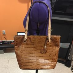 Michael Kors bag Tan Michael Kors bag. The outside has a couple scuffs, as seen in the last picture, but overall it's in good condition. The inside is in perfect condition. Michael Kors Bags