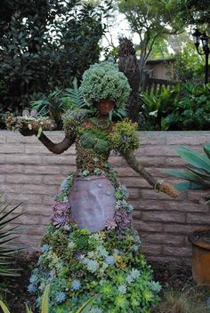 Life-sized topiary created by Pat Hammer, Director of Operations of the San Diego Botanical Garden. This included making clay masks of some of the garden and Horticultural Society to use as their faces.