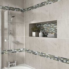 Probably our favorite use of accent tile. We use quality products from Daltile when remodeling bathrooms in the Central PA area. Consider the rich look of tile and recessed shelving when considering your bath or shower remodel. Shower Niche, Shower Tub, Bathroom Showers, Master Shower, Glass Bathroom, Mosaic Bathroom, Master Tub, Shower Window, Bathroom Vanities