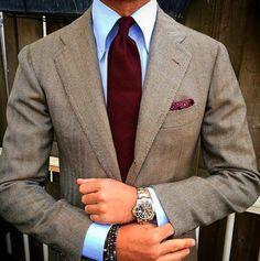 Light brown tweed jacket, light blue shirt, dark red tie