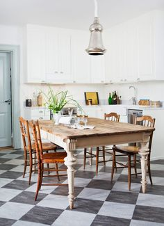 Not a huge fan of the traditional black & white checkered floor, but like this marble approach with softer colors