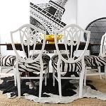 dining rooms - glossy white shield back chairs zebra cushions wood dining table black white cowhide rug layered jute rug  Erin gates Interiors