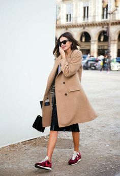 camel coat, leather pencil skirt, sneakers