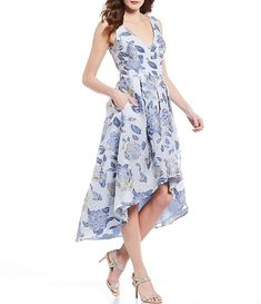 Light blue floral dress with high-low midi hemline  #affiliatelink #springdresses #weddingguestdress #bluedress
