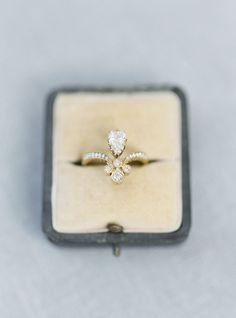 A one-of-a-kind engagement ring: http://www.stylemepretty.com/2016/02/22/30-must-haves-to-plan-the-ultimate-cool-girl-wedding/