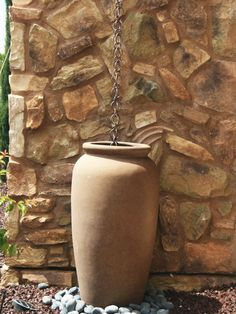 This rustic link rain chain drapes beautifully into this beautiful vessel container enhanced with ground rocks to form a beautiful, effortless landscape design and graceful look . Rain Barrel Stand, Rain Collection, Outdoor Retreat, Outdoor Spaces, Outdoor Decor, Rainwater Harvesting, Water Features, Backyard Landscaping, Landscape Design