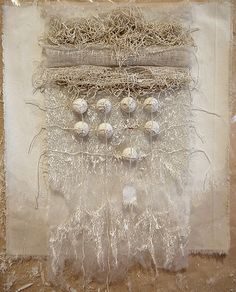 by Marga Dirube, objet deart con la técnica del bordado, collage, engessado, en colores tierra, sepia.