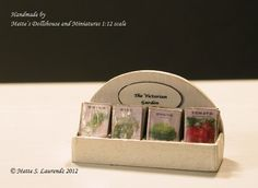 Dollhouse Miniature Seed Packets Display Box - Cream - with 20 miniature vegetable seed packets - 1:12 Scale (SPDB7). €14.00, via Etsy.
