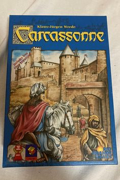 Carcassonne is an interesting one on this list for me. It had its time and place on the table and it is still in my collection to this day. It does not hit the table as often, but it is still a game I recommend to new people in the hobby. Why is that? Once again the simple rule-set and ease of introducing to new people. You pick and place a tile, decide to add a meeple, and score accordingly. The meeple can be a thief (highwayman), knight, monk, or farmer. The farmer concept and scoring... Games W, Man Games, Games To Buy, Board Games, Rio Grande, Carcassonne Board Game, Most Popular Boards, Scout Badges, Traditional Games