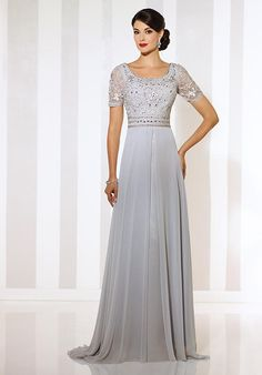Short sleeve chiffon A-line gown with front and back wide scoop necklines, ribbon work bodice with hand-beaded natural waistband, flyaway skirt with center front split and sweep train.