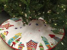 Appliqué Christmas Tree Skirt, Made to order, Whimsical Tree Skirt, Houses, Trees, Stars, Bright Colors and Bold Designs, So Much Fun! The price is for one tree skirt that is approximately 60 diameter is $390. If you would like a smaller size, a 58 diameter would be $365. And a