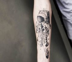 Astronaut tattoo by Felipe Mello