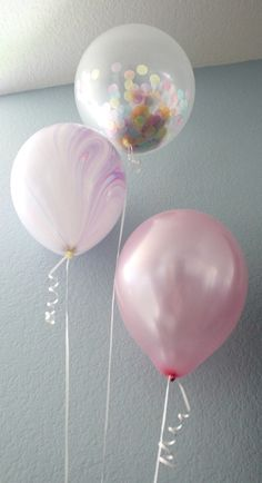 Confetti and iridescent balloons from a Pastel Iridescent Unicorn 2nd Bday Party at Kara's Party Ideas.