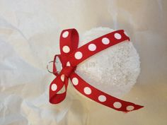 Clear glass ornament smothered in Modge Podge dipped in Epsom Salt, tied with a pretty bow. Easy DIY Christmas ornament.