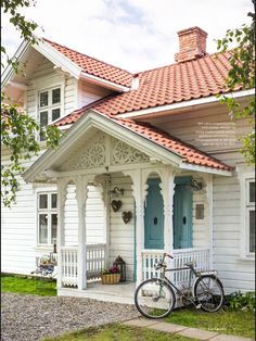 This is particularly nice, if a bit over the top on the gingerbread. Swedish Cottage, Swedish House, Norwegian House, Cottage Porch, Red Roof, Home Upgrades, Scandinavian Home, White Houses, House Goals