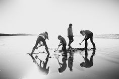 Family Documentary Photography - Black and White kids dig in sand on the beach