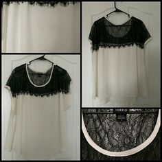Lace inset top Lace and chiffon top from torrid.  Colors are black and white.  Nice loose fitting shirt.  Torrid size 2, true to size. Item is in great condition minus a small stain on front, can be seen in pictures. torrid Tops Blouses