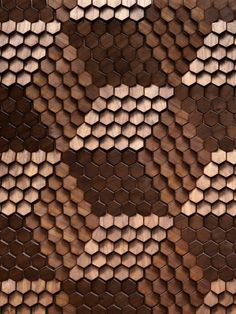 textured wood hexagons turn the wall into 3D cubes